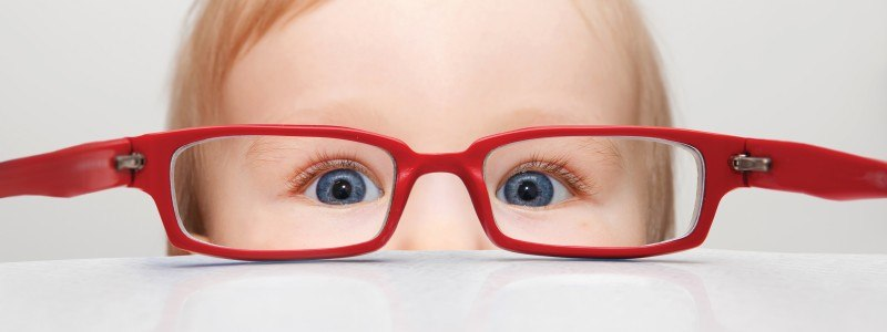 Toddler-looking-through-glasses